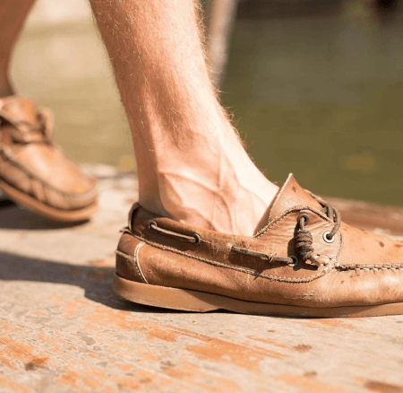 Boater shoes worn by a punter